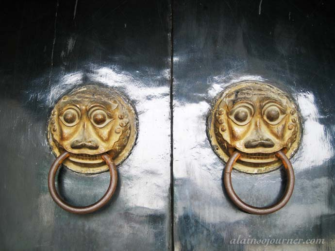 Chinese Doors and Their Scary-Looking Doorknobs
