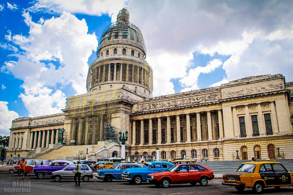 Sit in Parque Central in Havana.