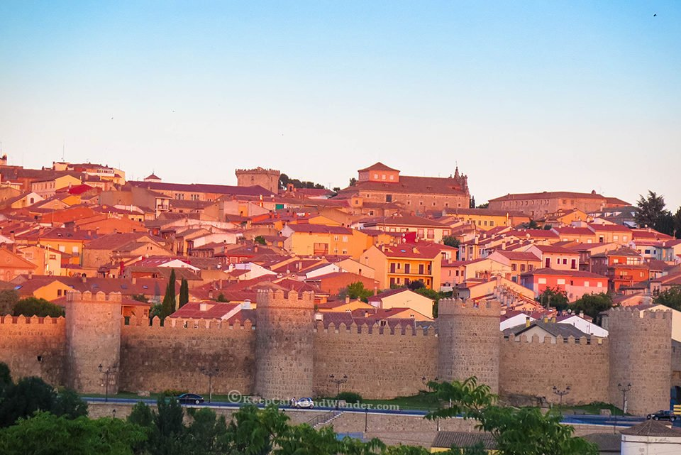 Watch the sunset in Avila (Spain) from outside the walls and see how the city turns gold.