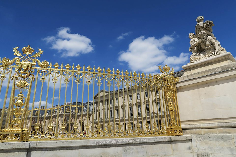 The Golden Gate of the Palace of Versailles Displays Excess Opulence of French Royalty (France).