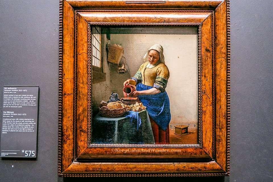 The Milkmaid by Johannes Vermeer inside Rijksmuseum in Amsterdam (Netherlands).