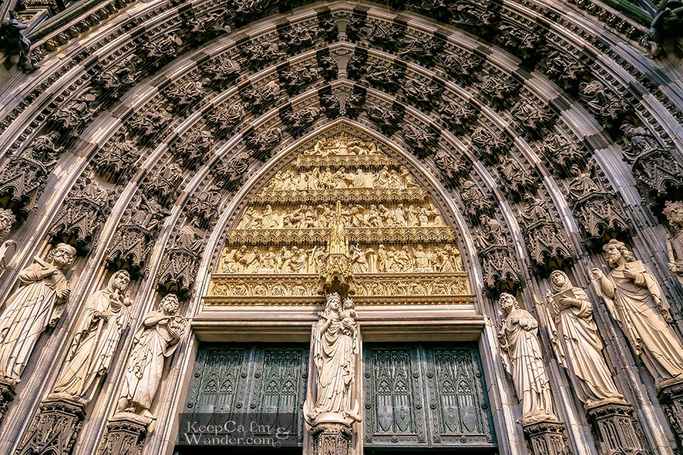 The religious statues at the entrance door (Germany). Travel Blog